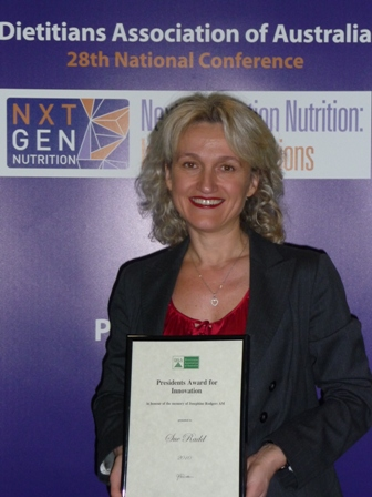 Sue acception the Award from the DAA
